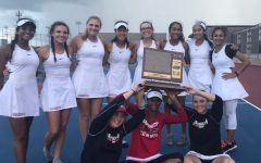 "The varsity girls' tennis team poses with their number one conference trophy. The team tied with Fremd High School for the title. ""I'm really proud of our team because no one expected us to win,"" senior and team captain Kathleen Tomasian said. ""Fremd had stronger players and a lot of other coaches in our conference expected Barrington to be taken out. Towards the end of the day, we were feeling pretty down because we thought that Fremd had got it, but when coaches were counting points and they realized it was a tie, we were ecstatic, we were all so happy."" Photo courtesy of Tracy Waters."