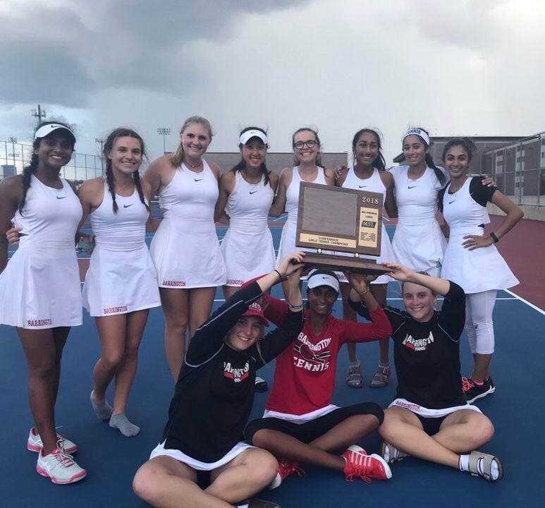 The+varsity+girls%27+tennis+team+poses+with+their+number+one+conference+trophy.+The+team+tied+with+Fremd+High+School+for+the+title.+%E2%80%9CI%E2%80%99m+really+proud+of+our+team+because+no+one+expected+us+to+win%2C%E2%80%9D+senior+and+team+captain+Kathleen+Tomasian+said.+%E2%80%9CFremd+had+stronger+players+and+a+lot+of+other+coaches+in+our+conference+expected+Barrington+to+be+taken+out.+Towards+the+end+of+the+day%2C+we+were+feeling+pretty+down+because+we+thought+that+Fremd+had+got+it%2C+but+when+coaches+were+counting+points+and+they+realized+it+was+a+tie%2C+we+were+ecstatic%2C+we+were+all+so+happy.%E2%80%9D+Photo+courtesy+of+Tracy+Waters.+