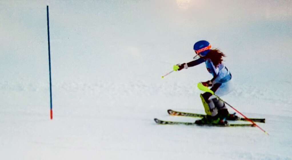 """Stephanie Espino races down a slope in Cascade, Wisconsin. After competing against the 16u girls, she wants to improve and reach their level. """"I want to get better so that I can ski anywhere without any limitations,"""" Espino said."""