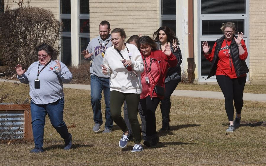 Barrington high school staff is shown above, participating  in the active shooter drill training.